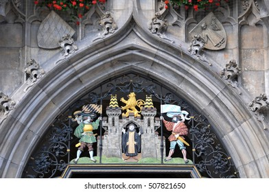 MUNICH, GERMANY - AUGUST 18, 2012: Detail of decorative figures in a door of the town hall