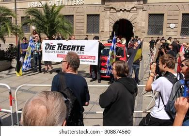 MUNICH, GERMANY - AUGUST 22: German rightist association (Die Rechte Kreisverband Munich) demonstrates against foreign refugees on Neuhauser street on August 22, 2015 in Munich.