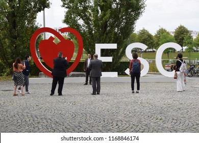 Munich, Germany - August 25, 2018: Participants of the European Cardiologists Congress in front of the conference logo