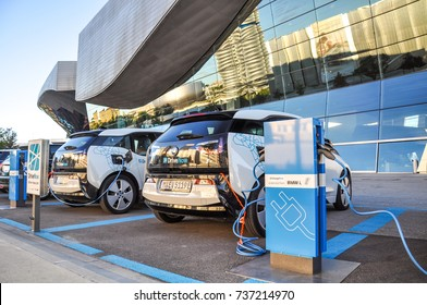 Munich, Germany - August 7, 2016: Two 'DriveNow' BMW i3 electric cars being charged at a charging station at 'BMW Welt' near BMW headquarters. 'DriveNow' is a car sharing company owned by BMW.