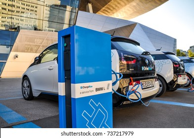 Munich, Germany - August 7, 2016: Three 'DriveNow' BMW i3 electric cars being charged at a charging station at 'BMW Welt' near BMW headquarters. 'DriveNow' is a car sharing company owned by BMW.