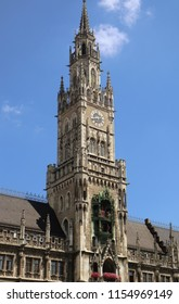 Munich Germany - the clock tower of the new City Hall in Marienplatz richly decorated in Gothic Revival architecture and the  Glockenspiel with the medieval life-size figures