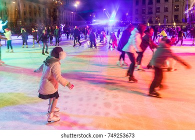 MUNICH, GERMANY - DECEMBER 11, 2016: People ice skating in Karlsplatz. On Christmas time a large ice rink is available during day and evening in the famous square of the city