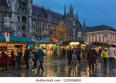 MUNICH, GERMANY - DECEMBER 12, 2017: The city's main Christmas market on the Marienplatz square in front of the New Town Hall in twilight. This is the largest and oldest Christmas market in the city.