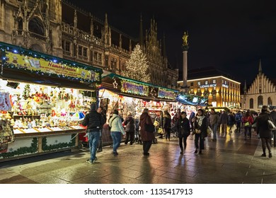 MUNICH, GERMANY - DECEMBER 12, 2017: The city's main Christmas market on the Marienplatz square in front of the New Town Hall in night. This is the largest and oldest Christmas market in the city.
