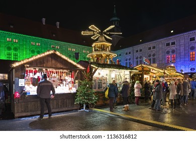 MUNICH, GERMANY - DECEMBER 12, 2017: Christmas Village in Emperor's Court (Kaiserhof) of Munich Residenz in night. This market has a assortment of different vendors selling traditional craft items.