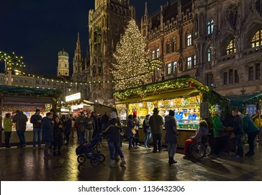 MUNICH, GERMANY - DECEMBER 12, 2017: The city's main Christmas market on the Marienplatz square in front of the New Town Hall in dusk. This is the largest and oldest Christmas market in the city.