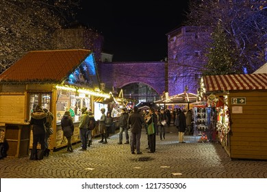 MUNICH, GERMANY - DECEMBER 12, 2017: Christmas market at Sendlinger Tor. This smaller market has been going since the mid-1990s. Sendlinger Tor is a city gate of the historic old town area of Munich.