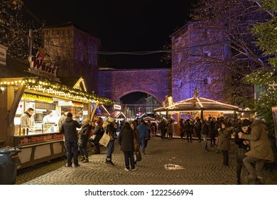 MUNICH, GERMANY - DECEMBER 12, 2017: Christmas market at Sendlinger Tor. This small market has been going since the mid-1990s. Sendlinger Tor is a city gate of the historic old town area of Munich.