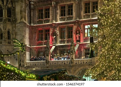MUNICH, GERMANY - DECEMBER 12, 2017: Advent music live from balcony of New Town Hall at city's main Christmas market. The show is performed every evening at 5.30pm while the Christmas market is held.