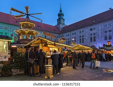 MUNICH, GERMANY - DECEMBER 15, 2017: Christmas Village in Emperor's Court (Kaiserhof) of Munich Residenz in twilight. This market has a assortment of different vendors selling traditional craft items.