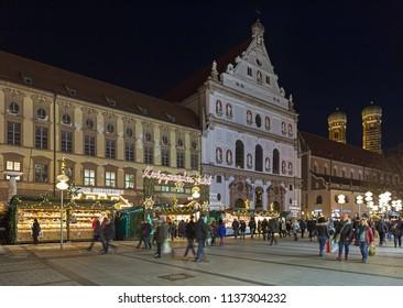 MUNICH, GERMANY - DECEMBER 15, 2017: Kripperlmarkt (Crib-market) on Neuhauser Strasse close to St. Michael's Church in dusk. The Kripperlmarkt offers everything that is needed to make a Nativity scene