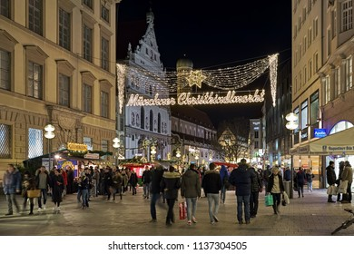 MUNICH, GERMANY - DECEMBER 15, 2017: Neuhauser Strasse with Christmas decoration in dusk. The Neuhauser Strasse leads to the city's main Christmas market on the Marienplatz square.