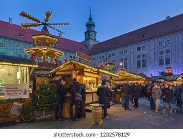 MUNICH, GERMANY - DECEMBER 15, 2017: Christmas Village in the Emperor's Court (Kaiserhof) of the Munich Residenz in twilight. In this Christmas market is re-created a real Christmas alpine village.