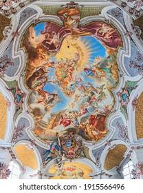 MUNICH, GERMANY - DECEMBER 15, 2017: Ceiling fresco of abbey church of St. Anna im Lehel. Church was built in 1727-1733 by Johann Michael Fischer. The fresco was created by Cosmas Damian Asam in 1730.