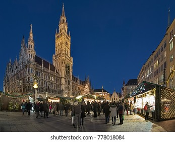 MUNICH, GERMANY - DECEMBER 15, 2017: Panoramic view of Christmas market on the Marienplatz square in front of the New Town Hall in twilight. This is the largest and oldest Christmas market in the city