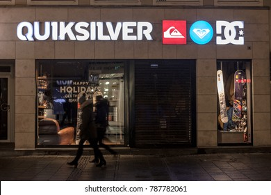 MUNICH, GERMANY - DECEMBER 17, 2017: Quiksliver logo on their Munich main shop taken at night. Quiksilver is an American retail sporting company