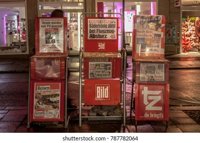 MUNICH, GERMANY - DECEMBER 17, 2017: German newspaper Bild Zeitung for sale in the streets of Munich on stands, surrounded by TV Journal and ZT. Bild Zeitung is one of the biggest tabloids of Germany