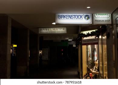 MUNICH, GERMANY - DECEMBER 17, 2017: Birkenstock logo on a Munich reseller Store taken during a snowy night. Birkenstock is a shoe manufacturer famous for its sandals