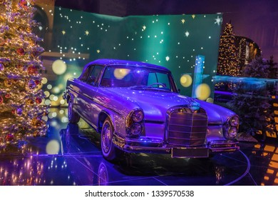 Munich, Germany, December 2018 - Vintage classic Mercedes benz displaying in a illuminated motion lighting room.
