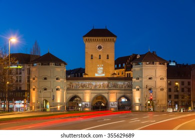 MUNICH, GERMANY - DECEMBER 24, 2015: Long exposure of the Isartor at Isartorplatz in Munich, one of four main gates of the medieval city wall, at night.