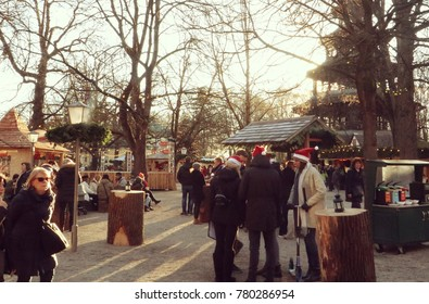 MUNICH, GERMANY - DECEMBER 7, 2017 - Munich, people at Englischer Garten Christmas market ,  like a small village in the woods near the Chinese tower