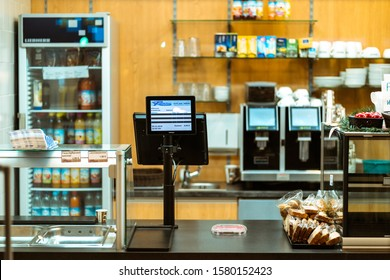 Munich, Germany - Dez. 05. 2019: Empty cash desk in illuminated store during night in munich city. No people in the frame