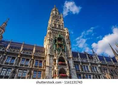 Munich Germany, Europe - The famous clock tower of the new City Hall in Marienplatz richly decorated in Gothic Revival architecture and the Glockenspiel with the medieval life-size figures