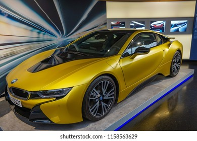 "MUNICH, GERMANY, EUROPE - JUNE 2018: The BMW i8 in The BMW Museum. It is a plug-in hybrid sports car developed by BMW. The i8 is part of BMW's electric fleet ""Project i"""