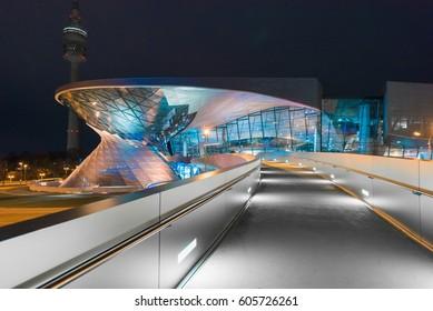 MUNICH, GERMANY - FEB 05, 2017: BMW World (BMW Welt) with Olympic Tower illuminated