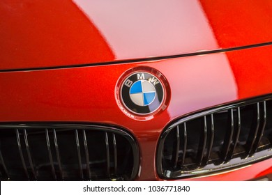Munich, Germany - February 10, 2018: Illustrative editorial image of a BMW logo displayed on a car's steering wheel in BMW WORLD Munich Museum . BMW is a German car manufacturer.