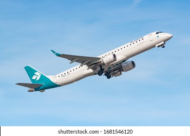 Munich, Germany - February 15, 2020: Air Dolomiti Embraer E190 airplane at Munich airport (MUC) in Germany. Embraer is an aircraft manufacturer from Brazil.