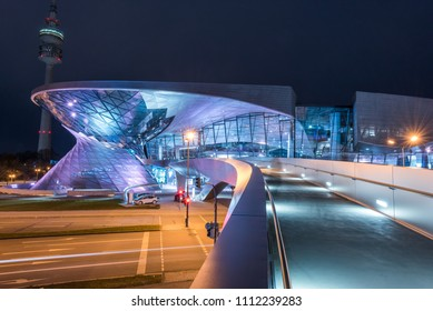 Munich, Germany - february 17, 2017: BMW i3 electric car standing at a charging station at BMW Welt World of BWM with exhibition and museum buildings at sunset with sunlight. Focus on background