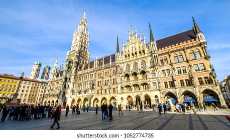MUNICH, GERMANY - FEBRUARY 6: tourists near New Town Hall at Marienplatz Square in Munich, Bavaria, Germany on February 6 - 2018.