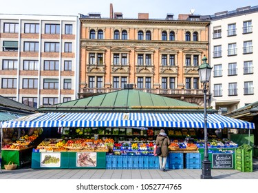 Munich, Germany - February 6: View of Viktualienmarkt a sunny day of winter. It is a daily food market and a square in the center of Munich near Marienplatz on February 6, 2018