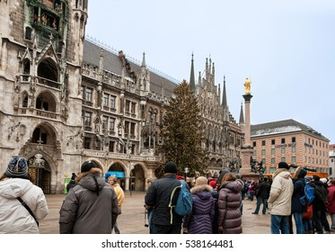 MUNICH, GERMANY - JANUARY 01, 2011 - Many people watch the show vintage chimes on the tower of the New Town Hall in Munich
