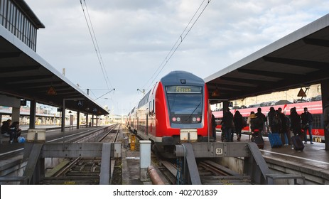 Munich, Germany - January 06 2016: Tourists go to the train traveling to Fussen on the platform of the Railroad Station in Munich
