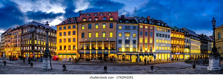 Munich, Germany - January 20: historic facades and stores of the famous Residenstrasse Street in munich on January 20, 2020