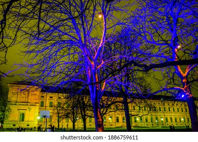 """Munich, Germany - January 3: Light installation in the art area of Munich on the Alte Pinakothek building- Motto: """"The art area connects"""" by Betty Mü and WE ARE VIDEO in Munich on January 3, 2021"""