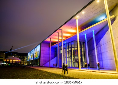 """Munich, Germany - January 3: Light installation in the art area of Munich on the neue Pinakothek building - Motto: """"The art area connects"""" by Betty Mü and WE ARE VIDEO in Munich on January 3, 2021"""
