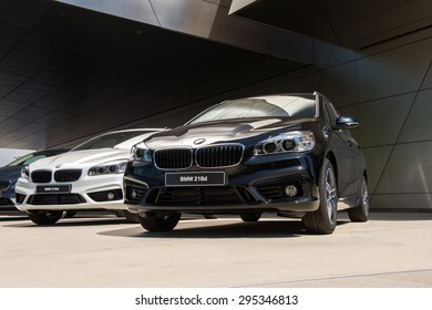 MUNICH, GERMANY - JULY 1, 2015: BMW 218d at the BMW Welt, a customer experience and exhibition facility of the BMW AG, Munich, Germany