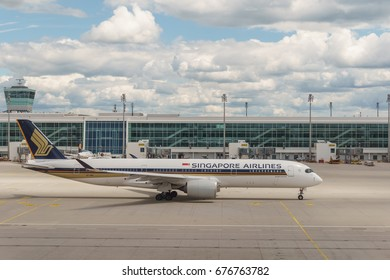 MUNICH, GERMANY - JULY 1, 2017: The very first Airbus A350 flight out of Munich, Germany leaves Munich Airport on its way to Singapore.