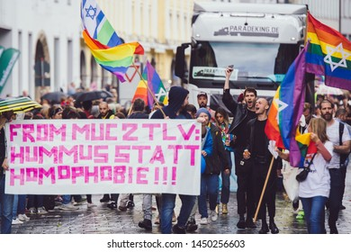 Munich, Germany - July 13, 2019: Rainbow flag banner demonstrating for gay lesbian quality rights during pride parade christopher street day munich