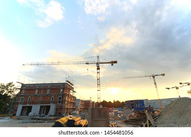 Munich, Germany - July 15, 2019 - construction site of upmarket living quarters at western suburbia, sunset lighting