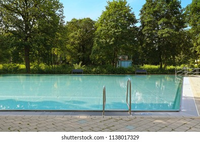 MUNICH, GERMANY -JULY 17, 2018 Wonderful summer weather and leisure time for a swim at one of the popular swimming baths in Munich
