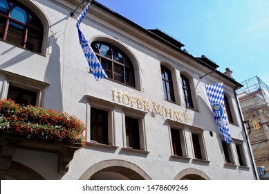 MUNICH, GERMANY - JULY 2013: Exterior of Hofbräuhaus with Bavarian flag banners. The Hofbräuhaus am Platzl is a beer hall in Munich, Germany, originally built in 1589 by Bavarian Duke Maximilian I.