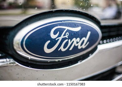 Munich, Germany, July 21, 2018. Ford Symbol on car front hood with water drops.