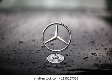 Munich, Germany, July 21, 2018. Mercedes Benz Star Symbol on car hood with water drops after rain.