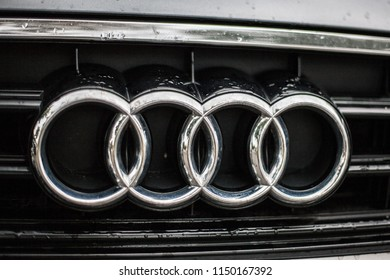Munich, Germany, July 21, 2018. Audi Rings on car front grill with water drops.