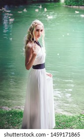 Munich, Germany - July 21, 2019: Young woman lady cosplay as game of thrones daenerys targaryen in green nature background
